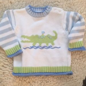 Baby sweater with alligator